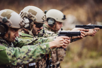 Special operations training in marksmanship at firing range. People and military concept.