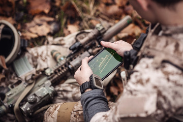 soldiers holding gps in hand and determines the location of coordinates.