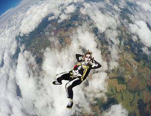 Woman costumed skeleton in free fall. Skydiving Happy Halloween.
