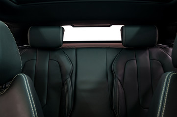 Leather back passenger seats in modern car. Interior detail.