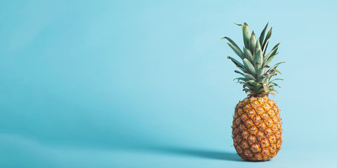 Whole pineapple on a bright blue background Wall mural
