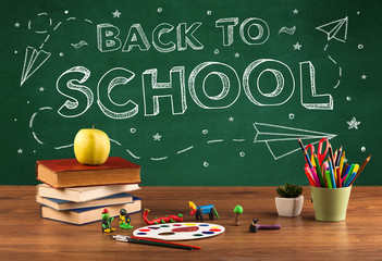 Back to school blackboard and student desk