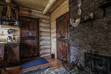 rustic wooden hallway with two old-style doors in vintage cabin
