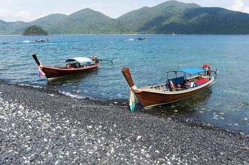 Long trail Boats On Beautiful tropical rocks Beach, Krabi, Thailand