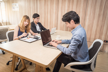 Group of Business People Working in the Office with labtop and graphic document Concept.
