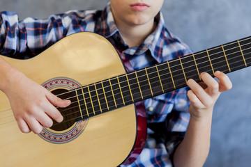 Cute teen boy with guitar