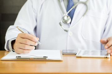 Professional doctor writing note for medical records about new patient