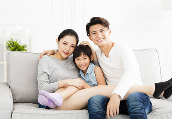Happy asian family on sofa in living room