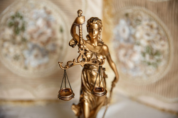 Judge, deciding on marriage divorce. Themis with wedding rings on scales. Justice concept