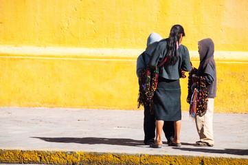 Local children at the streets of San Cristobal de las Casas, Mexico.