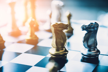 winning chess board game competition for successful company and strategy research business concept in blur image background of morning sun light