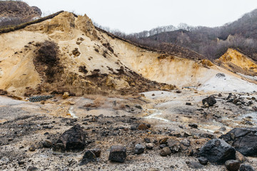 Noboribetsu Jigokudani (Hell Valley): The volcano valley got its name from the sulfuric smell, extremely high heat and steam spouting out of the ground in Hokkaido, Japan.