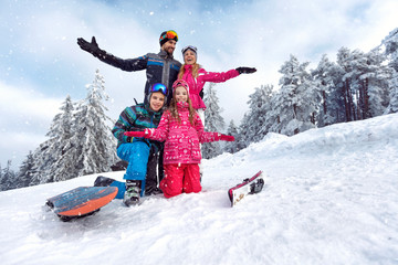 family enjoying and having fun on winter vacation together on the mountain