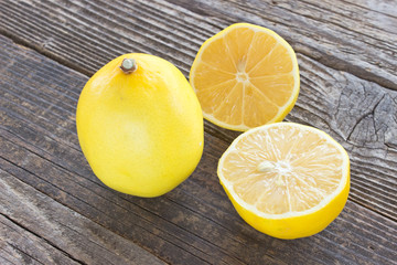 Two lemons on wooden background