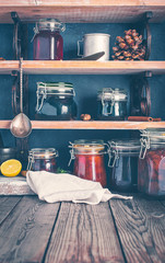 Fresh various jars of homemade jam on shelves