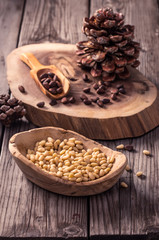 Wooden bowl of peeled pine nuts on rustic table
