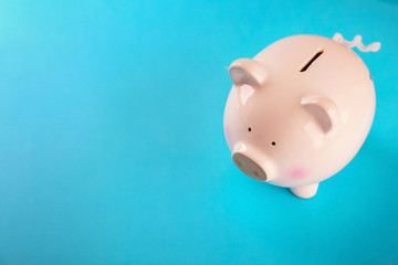 Cute piggy bank on color background