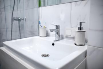 White ceramic sink in bathroom