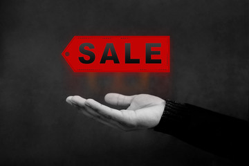 Sale and Promotional Concept, Hand opened to present a sale Tag