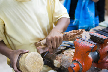 Craftsman carving a souvenir from wood