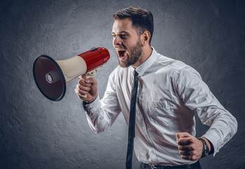 businessman screaming into a megaphone