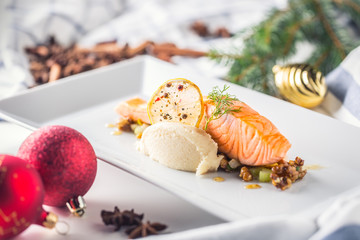 Christmas food with salmon fillet and decoration home hotel or restaurant