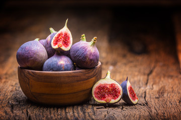 Figs. A few figs in a bowl on an old wooden background Wall mural