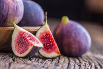 Figs. A few figs in a bowl on an old wooden background