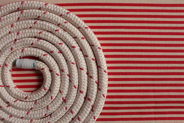 Rope round spiral red striped flat lay background