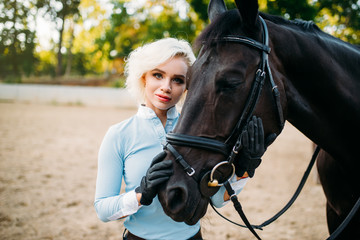 Portrait of woman and horse, horseback riding