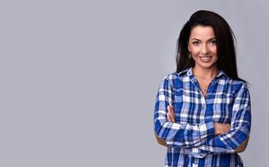 toothy smiling woman in casual blue shirt. Isolated
