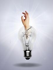 Light bulb on light gray background