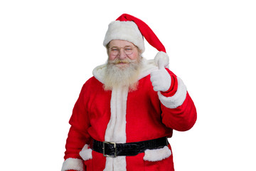 Smiling Santa giving thumb up. Happy senior Santa Claus giving thumb up gesture isolated on white background. Portrait of realistic Santa with ok gesture.