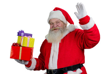 Portrait of happy Santa Claus with gifts. Cheerful Santa Claus waving with hand, isolated on white background.