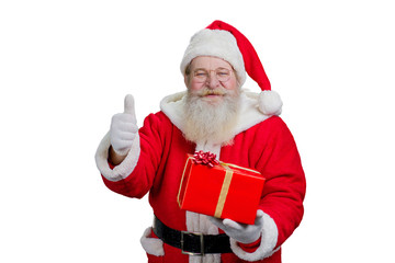Happy Santa Claus giving thumb up. Portrait of realistic Santa Claus with Christmas present giving thumb up gesture on white background. Christmas happiness and gifts.