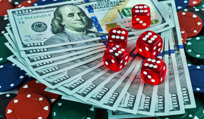 Casino dices money on gaming table us dollar bill