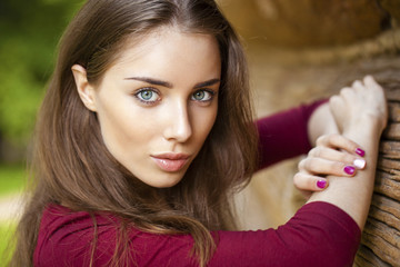 Beautiful young brunette woman in dress