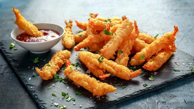Fried Shrimps tempura with sweet chili sauce on black board stone
