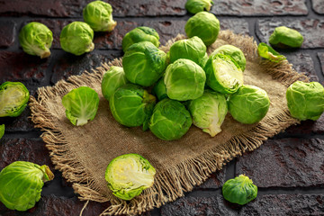 fresh raw brussels sprouts on a old stone rustic table