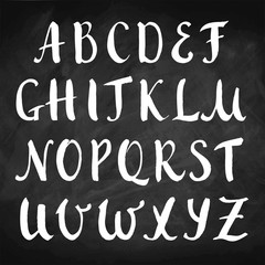 Vector hand drawn alphabet on chalkboard. Brush painted capital letters. Rough contour.