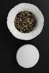 Black pepper, white pepper and salt in bowl