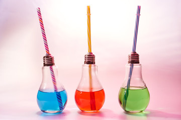 Light bulp shape glasses with colored cocktails