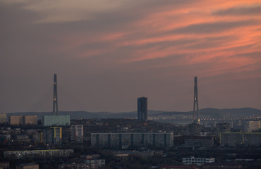 Vladivostok cityscape with dramatic sunset sky.