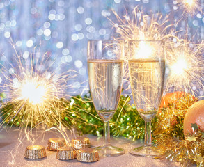 Still life of New Year Eve celebration with champagne and lights
