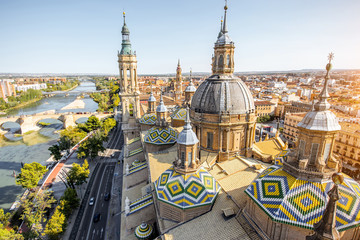 Aerial cityscape view on the roofs and spires of basilica of Our Lady in Zaragoza city in Spain Wall mural