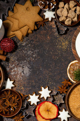 dark background with ingredients for Christmas baking, vertical