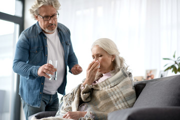 Sad mature woman caught a cold
