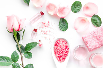 Natural organic cosmetics with rose oil. Cream, lotion, spa salt on white background top view