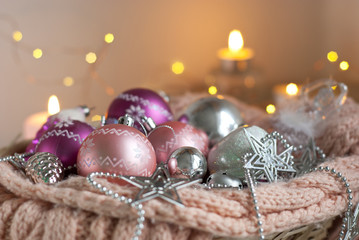 pink christmas decoration. balls and candles. selective focus