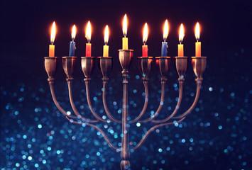 jewish holiday Hanukkah background with menorah (traditional candelabra) and burning candles